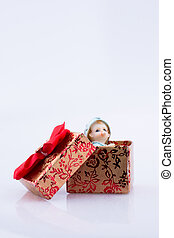Little baby figure in a gift box