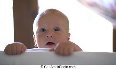 cute baby peeking out of hiding - little cute baby peeking...