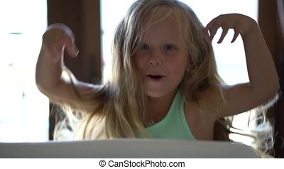 pretty little girl frightens for fun jumping out of hiding,...