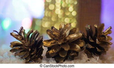 pine cones and a box with a gift on the background. Christmas background