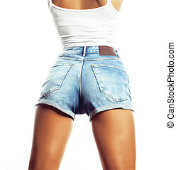 womans butt wearing blue jeans shorts isolated on white...