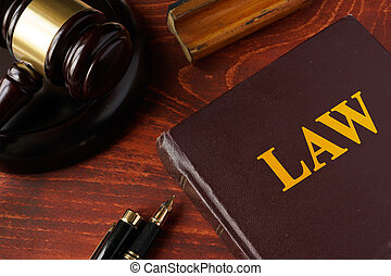Law concept.  A gavel and legal book.