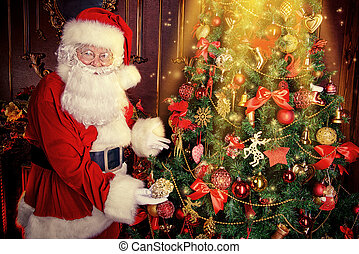 dress up tree - Santa Claus next to a beautiful ornate...