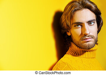 guy in yellow pullover - Handsome man wearing yellow...