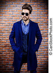 fashion male model - Portrait of a well-dressed imposing man...