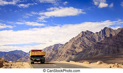 Road in Kashmir - A truck driving down the road in Ladakh...