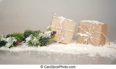 Christmas boxes for gifts and branches in the snow on a...