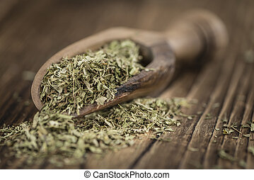 Heap of dried Stevia leaves (sweetener) on vintage...