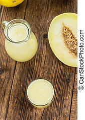 Healthy Honeydew Melon Smoothie (selective focus) on an old...