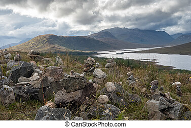 Loch Ness and surroundings - Inukshuks along the borders of...