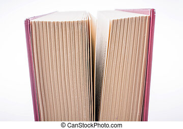 Book pages partly in view on white background