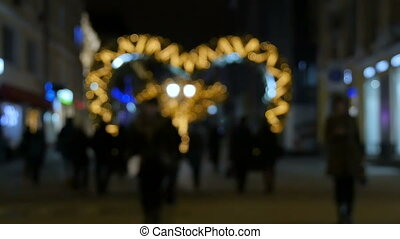 People walking on the street in the evening, a festive...
