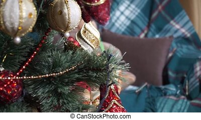Close-up view of a Christmas tree on a teddy bear on a chair