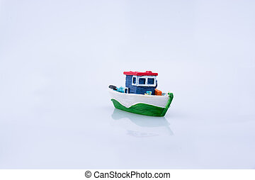 Little colorful model boat with windows on white background