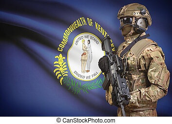 Soldier in helmet holding machine gun with USA state flag on background series - Kentucky