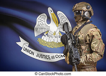 Soldier in helmet holding machine gun with USA state flag on background series - Louisiana