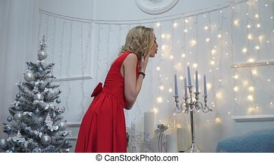 Girl blows out the candles in a candlestick and flirting on...