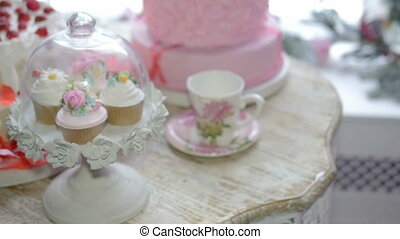 The composition mug with pink flowers and cakes. Abstract...