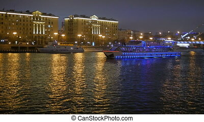 The ship sails on the river at night. - The ship is sailing...