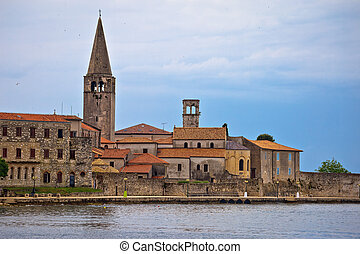 View of Porec town UNESCO landmark, Euphrasian basilica in...