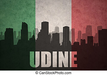 abstract silhouette of the city with text Udine at the...