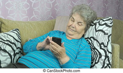 Senior woman using smartphone indoors