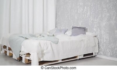 Modern bed with nice pillows - Modern white bed with cute...
