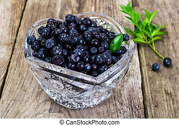 Bilberry in Crystal Bowl on Rustic Background - Bilberry in...