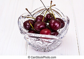 Cherries in Crystal Bowl on Rustic Background - Cherries in...