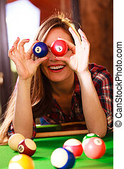 Young woman having fun with billiard. - Play jokes and fun...