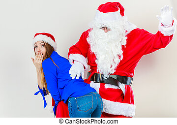 Attractive lady with Santa Claus. - Xmas time people...
