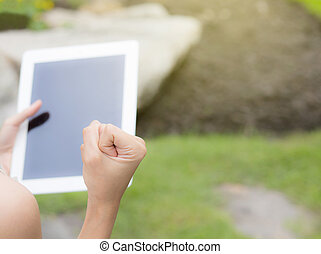 tablet with a blank screen in the hand with success