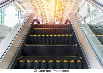 escalators stairway inside modern office building -...