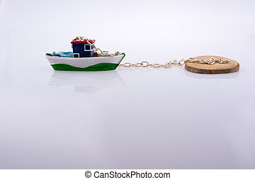 Little colorful model boat with chains on white background