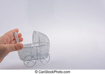 Toy  baby carriage in hand