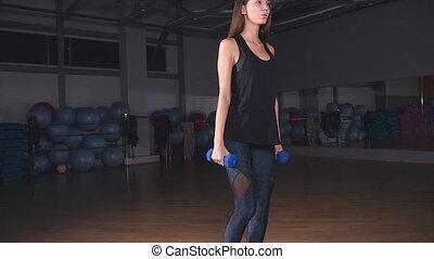 Female fitness girl exercising indoor in gym - Female...