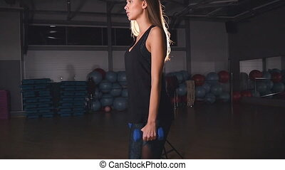 Female fitness girl exercising indoor in gym