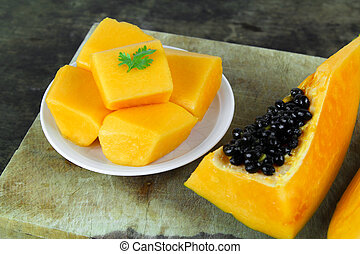 slice of sweet ripe papaya on white background