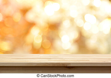 Wood table top on shiny gold bokeh abstract background - can...