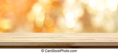 Wood table top on shiny gold bokeh abstract background -...