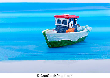 Little colorful model boat in water - Little colorful model...