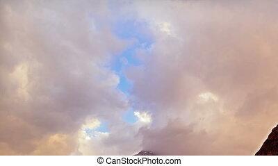 Clouds cling to the mountain. Pamir, Tajikistan