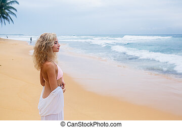 Beautiful young woman on beach