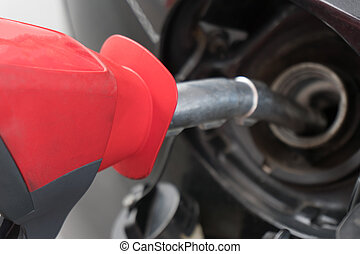 Refilling the car with fuel on a filling station.