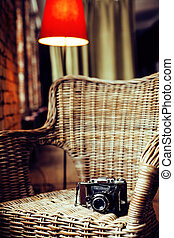 post card view. old fashion film camera in wooden chair,...