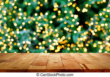 Wood table top with bokeh from decorative light on christmas...