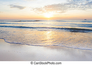 Bright sunrise over on the beach - Bright sunrise over the...