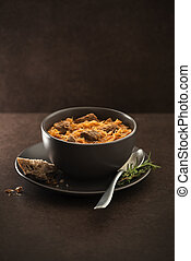 Goulash cabbage with beef on dark background.