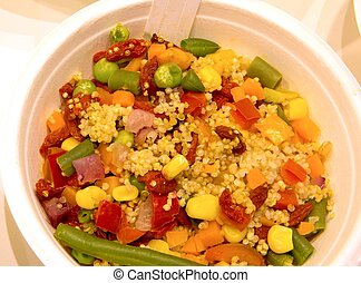 dish of boiled mixed vegetables and seeds of quinoa -...