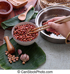 Vietnamese snack food, roasted peanut with red hot pepper,...